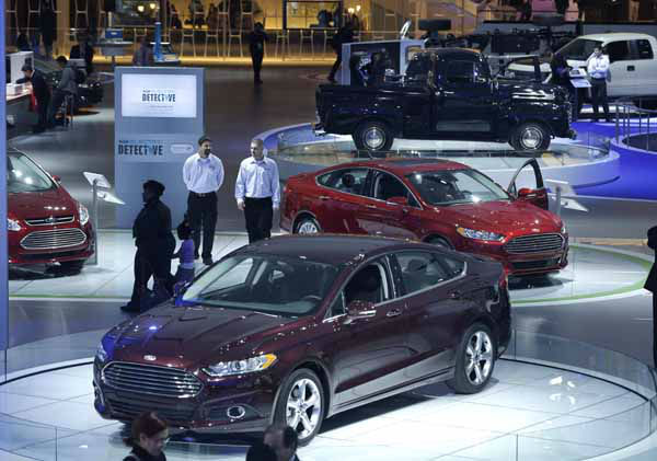 A Ford Taurus is seen in the foreground of the Ford display at the North American International Auto Show in Detroit, Monday, Jan. 14, 2013. &#40;AP Photo&#47;Carlos Osorio&#41; <span class=meta>(AP Photo&#47; Carlos Osorio)</span>