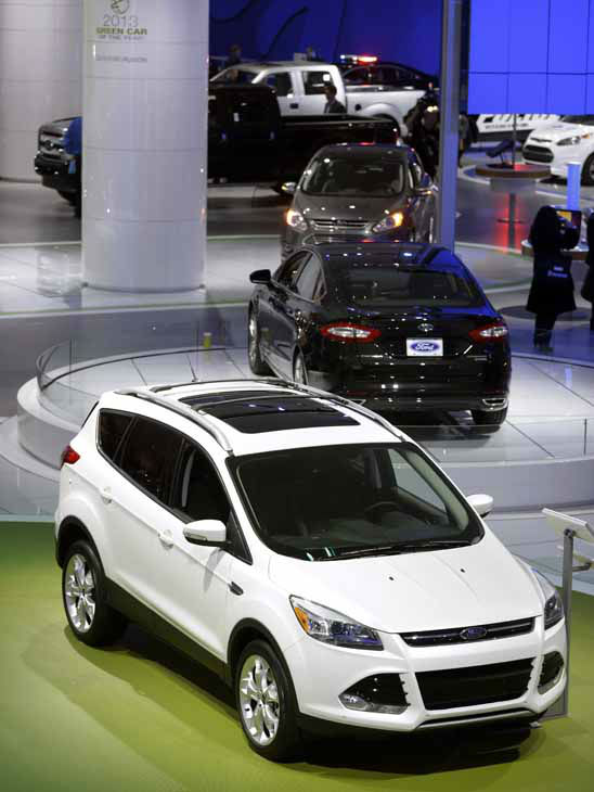 "<div class=""meta ""><span class=""caption-text "">A Ford Escape is seen in the foreground of the Ford display at the North American International Auto Show in Detroit, Monday, Jan. 14, 2013. (AP Photo/Carlos Osorio) (AP Photo/ Carlos Osorio)</span></div>"