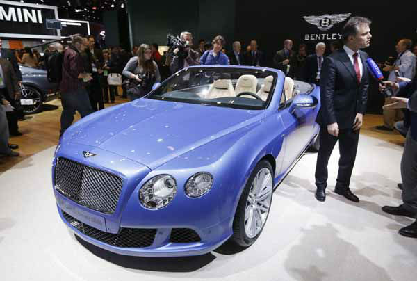 Bentley Chairman and CEO Wolfgang Schreiber unveils the GT Speed Convertible during the North American International Auto Show in Detroit, Monday, Jan. 14, 2013. &#40;AP Photo&#47;Carlos Osorio&#41; <span class=meta>(AP Photo&#47; Carlos Osorio)</span>