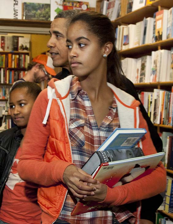 In this Nov. 26, 2011 file photo, President Barack Obama shops with his daughters Malia, foreground, and Sasha, in Washington.  (AP Photo/Carolyn Kaster, File)