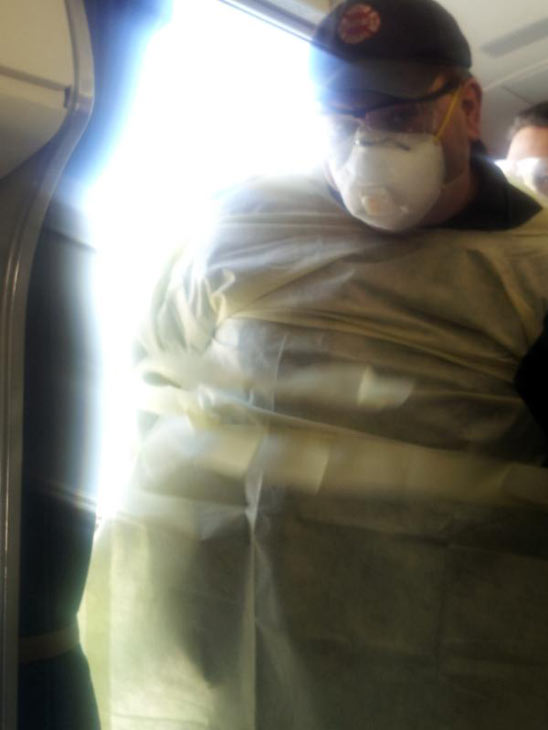 "<div class=""meta image-caption""><div class=""origin-logo origin-image ""><span></span></div><span class=""caption-text"">Image from Twitter: @flipsideagency: ""so the CDC is on board, the passenger is being examined and we are officially quarantined""</span></div>"