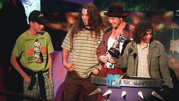 FILE--Members of the grunge group Pearl Jam celebrate their MTV award for best group video, one of four awards the band won, for their video teen suicide lament, Jeremy, at the MTV Video Music Awards in 1993. They are, left to right, Stone Gossard, Dave Abrunnsee, Jeff Ament, and lead singer Eddie Vedder. (AP Photo/ Kvork Djansezian)