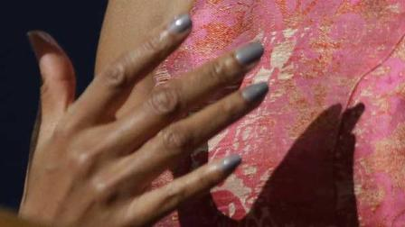 Michelle Obamas manicure is shown next to her Tracy Reese dress at the DNC.