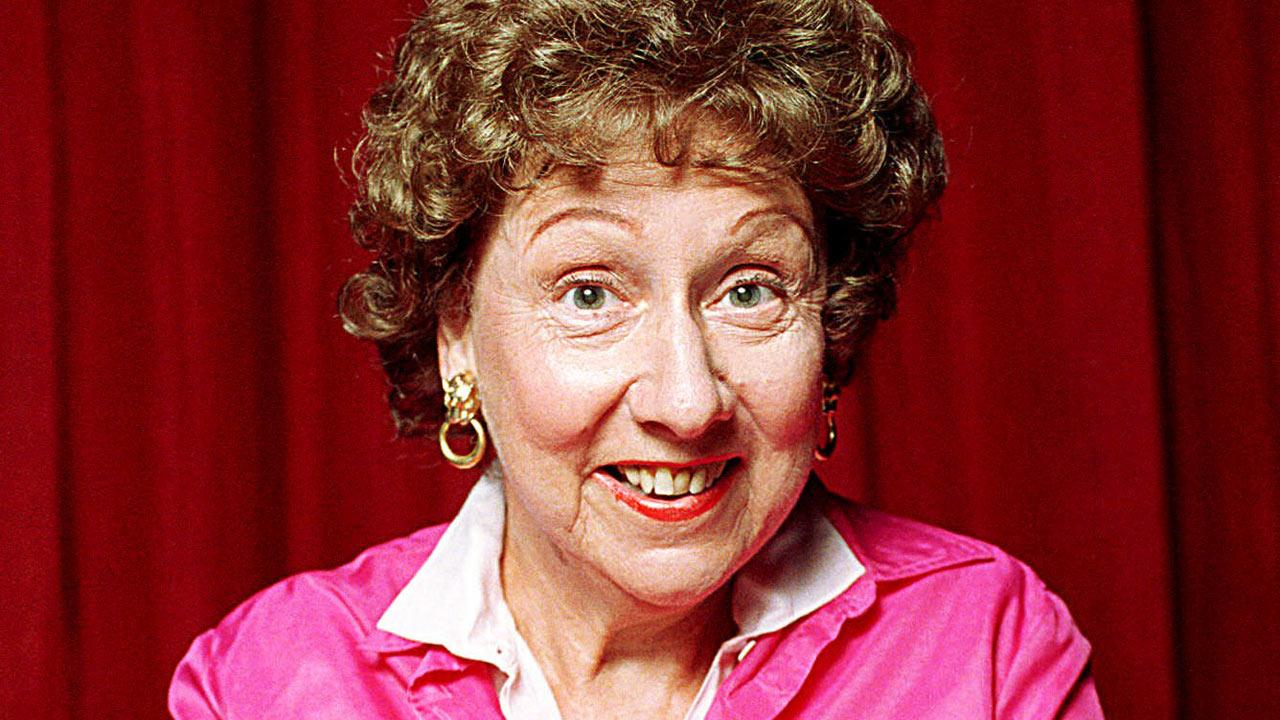 Actress Jean Stapleton stars in an off-Broadway musical  Bon Appetit.  In the show, she sings a Julia Child recipe for Gateau au Chocolat l Eminence Brune, otherwise known as chocolate cake. Photo is undated.