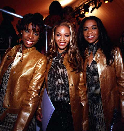 Members of the R&#38;B group Destiny&#39;s Child, from left, Kelly Rowland, Beyonce Knowles, and Michelle Williams pose together after they attended the Nicole Miller fashion show Tuesday, Sept. 19, 2000, in New York.  <span class=meta>(AP Photo&#47;Robert Mecea)</span>