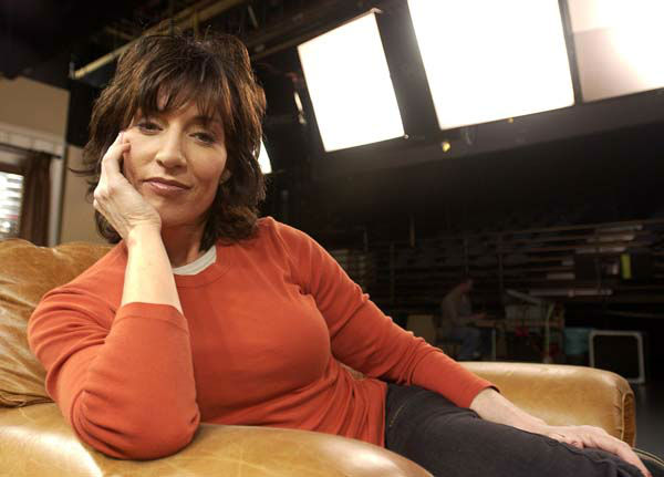 Actress Katey Sagal relaxes between takes on the set of the ABC sitcom &#34;8 Simple Rules for Dating My Teenage Daughter,&#34; at Disney Studios in Burbank, Calif., March 20, 2003. Sagal is paired with actor John Ritter as parents to three teenage daughters. &#40;AP Photo&#47;Chris Pizzello&#41; <span class=meta>(Photo&#47;CHRIS PIZZELLO)</span>