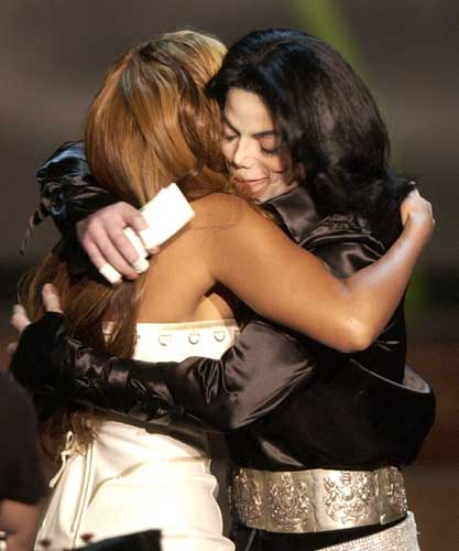 Beyonce Knowles, left, embraces Michael Jackson as she presents him a humanitarian award during the Radio Music Awards Monday, Oct. 27, 2003, at the Aladdin Hotel in Las Vegas.  <span class=meta>(AP Photo&#47;Joe Cavaretta)</span>