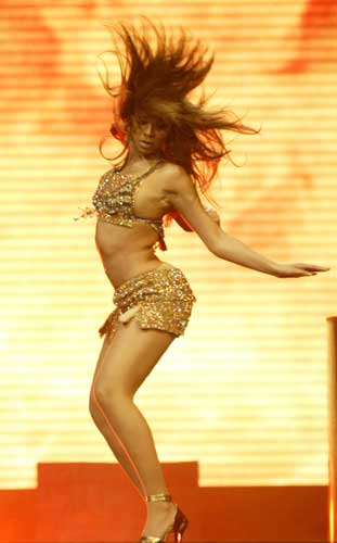 Beyonce Knowles performs Friday, March 12, 2004, in Sunrise, Fla. Beyonce, Alicia Keys and Missy Elliott started &#39;&#39;The Ladies First,&#39;&#39; tour tonight.  <span class=meta>(AP Photo&#47;Mike Fuentes)</span>