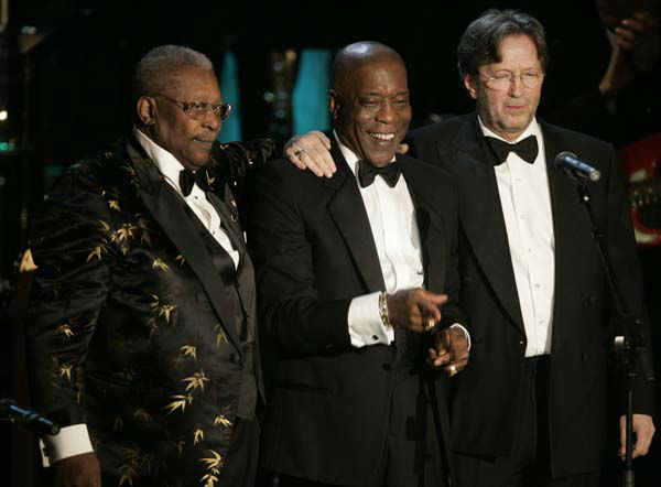 "<div class=""meta image-caption""><div class=""origin-logo origin-image ""><span></span></div><span class=""caption-text"">Buddy Guy, center, stands with B.B. King, left, and Eric Clapton after performing during the Rock and Roll Hall of Fame induction ceremony Monday, March 14, 2005 in New York. (AP Photo/Julie Jacobson) (AP Photo/ JULIE JACOBSON)</span></div>"