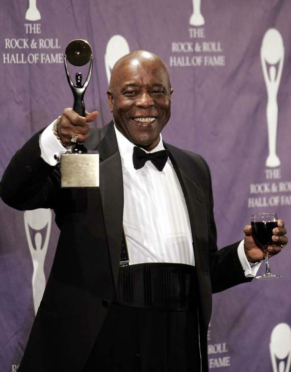 Buddy Guy holds up a trophy backstage after being inducted into the Rock and Roll Hall of Fame at an induction ceremony,  Monday, March 14, 2005, in New York. &#40;AP Photo&#47;Ed Betz&#41; <span class=meta>(AP Photo&#47; ED BETZ)</span>