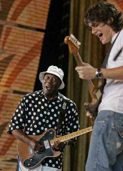 Buddy Guy, left, and John Mayer perform at the 20th anniversary Farm Aid concert, Sunday, Sept. 18, 2005, at the Tweeter Center, in Tinley Park, Ill. The day-long concert is the culmination of a week of events to benefit family farmers. &#40;AP Photo&#47;Brian Kersey&#41; <span class=meta>(AP Photo&#47; BRIAN KERSEY)</span>