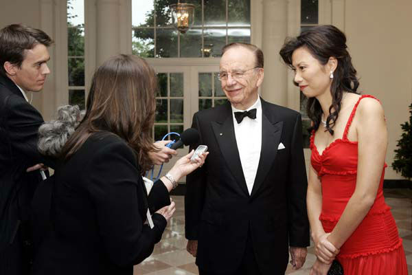 "<div class=""meta image-caption""><div class=""origin-logo origin-image ""><span></span></div><span class=""caption-text"">Rupert Murdoch, chariman and CEO of the News Corporation, second from right, talks to the media as he arrives to the White House with his wife Wendi Deng, right, for the official dinner honoring the Prime Minister of Australia John Howard on Tuesday, May 16, 2006 in Washington.  (AP Photo/Evan Vucci) (AP Photo/ EVAN VUCCI)</span></div>"