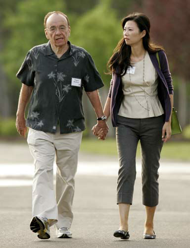 "<div class=""meta image-caption""><div class=""origin-logo origin-image ""><span></span></div><span class=""caption-text"">News Corp.'s Rupert Murdoch and his wife, Wendi Deng, arrive for the annual Allen and Co.'s media conference Wednesday, July 11, 2007, in Sun Valley, Idaho. (AP Photo/Douglas C. Pizac) (AP Photo/ Douglas C. Pizac)</span></div>"