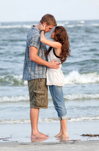 In this film publicity image released by Disney, Liam Hemsworth, left, and Miley Cyrus are shown in a scene from &#34;The Last Song.&#34;  <span class=meta>(AP Photo&#47;Disney, Sam Emerson)</span>