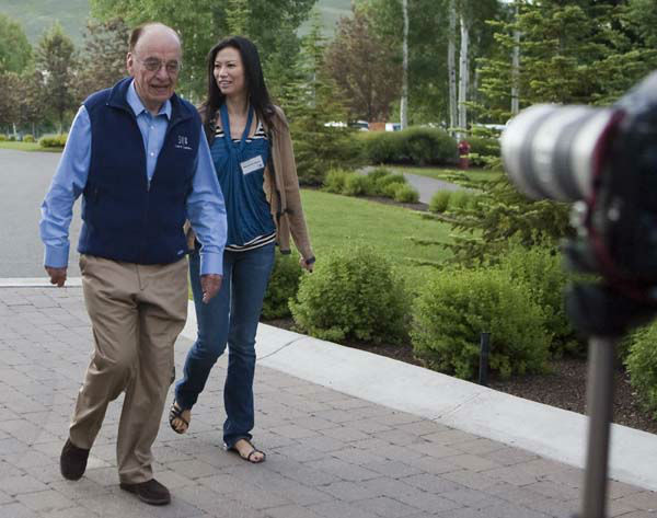 "<div class=""meta image-caption""><div class=""origin-logo origin-image ""><span></span></div><span class=""caption-text"">News Corp.'s Rupert Murdoch and Wendi Deng arrive for a morning session at the annual Allen & Co.'s media summit in Sun Valley, Idaho, Friday, July 10, 2009.(AP Photo/Nati Harnik) (AP Photo/ Nati Harnik)</span></div>"