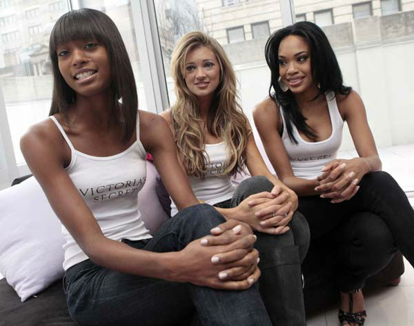 Three of ten finalists competing to be the next Victoria&#39;s Secret Runway Angel, from left, Katelyn Fortes, 18, of Boston; Kylie Bisutti, 19, of Simi Valley, Calif., and Raven Ervin, 24, of Birmingham, Ala., are interviewed in New York, Thursday, Nov. 5, 2009. &#40;AP Photo&#47;Richard Drew&#41; <span class=meta>(AP Photo&#47; Richard Drew)</span>