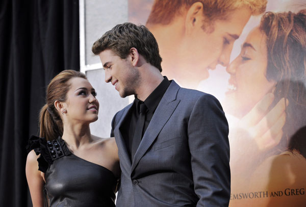 Miley Cyrus, left, and Liam Hemsworth, co-stars of the film &#34;The Last Song,&#34; pose together at the premiere of the film in Los Angeles, Thursday, March 25, 2010.  <span class=meta>(AP Photo&#47;Chris Pizzello)</span>