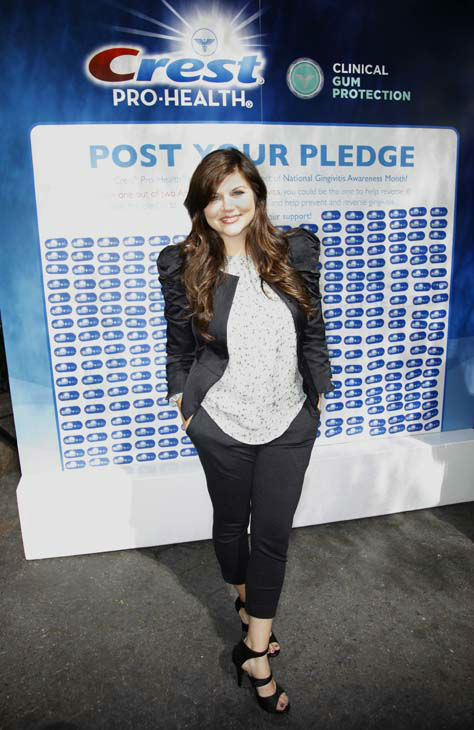 ** COMMERCIAL IMAGE ** In this photograph taken by AP Images for Crest Pro-Health - Actress Tiffani Thiessen, star of ?White Collar?, kicks off National Gingivitis Awareness Month, Wednesday, Sept. 15, 2010 at Greeley Square Park  in New York. Thiessen, in partnership with Crest Pro-Health, declared September National Gingivitis Awareness Month to help educate Americans on gingivitis and how they can help prevent and help reverse it using new Crest Pro-Health Clinical Gum Protection. &#40;Gary He&#47;AP Images for Crest Pro-Health&#41; <span class=meta>(Photo&#47;GARY HE)</span>