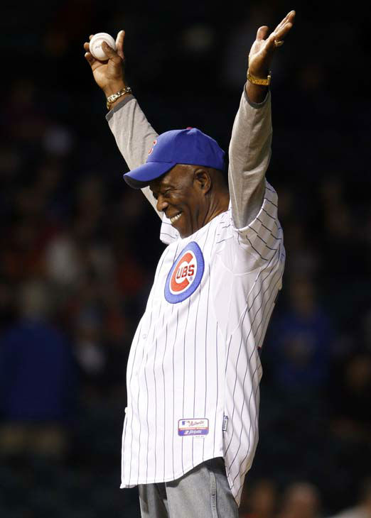 Chicago blues legend Buddy Guy waves to crowd before throwing out the ceremonial first pitch before the San Francisco Giants-Chicago Cubs baseball game Wednesday, Sept. 22, 2010, in Chicago. &#40;AP Photo&#47;Nam Y. Huh&#41; <span class=meta>(AP Photo&#47; Nam Y. Huh)</span>