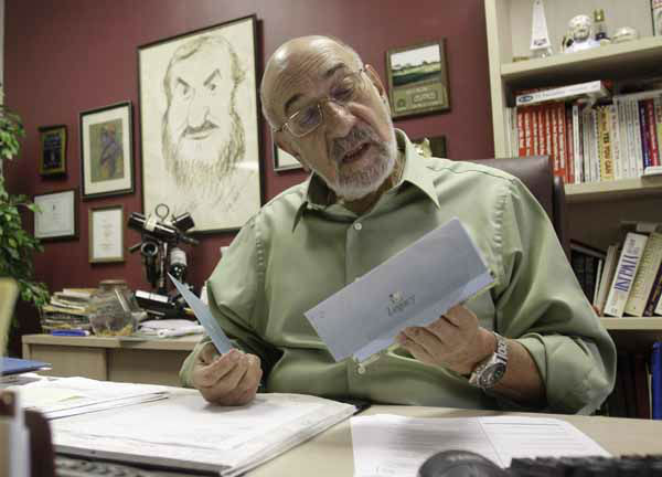 In this photo taken Wednesday, Oct. 13, 2010, Art Ginsburg, known as Mr. Food, reads fan mail at his office in Fort Lauderdale, Fla. Art Ginsburg has spent the past 30 years quietly turning himself into an unlikely food celebrity.   &#40;AP Photo&#47;Alan Diaz&#41; <span class=meta>(AP Photo&#47; Alan Diaz)</span>