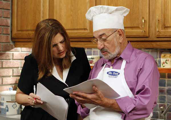 In this photo taken Thursday, Oct. 14, 2010, Art Ginsburg, known as Mr. Food, right, goes through the script with senior writer Helayne Rosenblum during the taping of his program in Fort Lauderdale, Fla. Art Ginsburg has spent the past 30 years quietly turning himself into an unlikely food celebrity.   &#40;AP Photo&#47;Alan Diaz&#41; <span class=meta>(AP Photo&#47; Alan Diaz)</span>