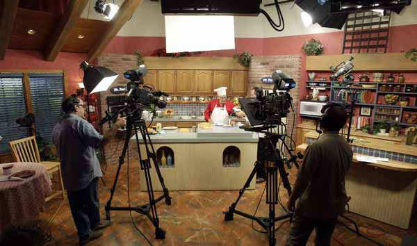 In this photo taken Thursday, Oct. 14, 2010, Art Ginsburg, known as Mr. Food, center, and crew prepare for taping of his program in Fort Lauderdale, Fla. Art Ginsburg has spent the past 30 years quietly turning himself into an unlikely food celebrity.   &#40;AP Photo&#47;Alan Diaz&#41; <span class=meta>(AP Photo&#47; Alan Diaz)</span>