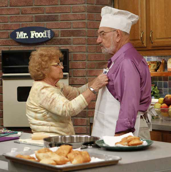 In this photo taken Thursday, Oct. 14, 2010, Ethel Ginsburg, left, prepares her husband Art Ginsburg, known as Mr. Food, for the taping of his program in Fort Lauderdale, Fla. Art Ginsburg has spent the past 30 years quietly turning himself into an unlikely food celebrity.   &#40;AP Photo&#47;Alan Diaz&#41; <span class=meta>(AP Photo&#47; Alan Diaz)</span>