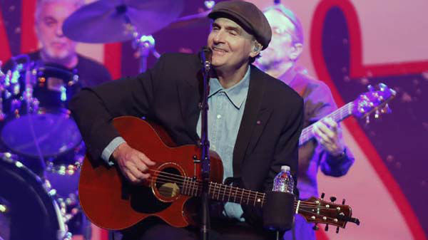 "<div class=""meta image-caption""><div class=""origin-logo origin-image ""><span></span></div><span class=""caption-text"">James Taylor performs at the Boston Strong Concert: An Evening of Support and Celebration at the TD Garden on Thursday, May 30, 2013 in Boston. (Photo by Bizuayehu Tesfaye/Invision/AP) (AP Photo/ Bizuayehu Tesfaye)</span></div>"