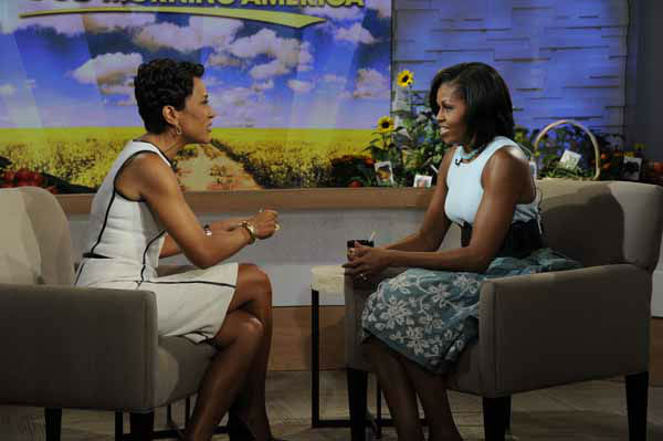 This image released by ABC shows  host Robin Roberts, left, speaking with first lady Michelle Obama on the morning program &#34;Good Morning America,&#34; Tuesday, May 29, 2012 in New York. Obama discussed a variety of topics including her new book &#34;American Grown: The Story of the White House Kitchen Garden and Gardens Across America,&#34; which promotes healthy eating. &#40;AP Photo&#47;ABC, Ida Mae Astute&#41; <span class=meta>(AP Photo&#47; Ida Mae Astute)</span>