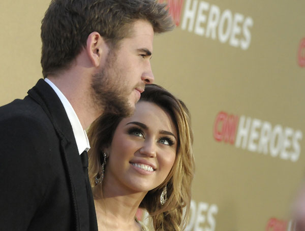 Actor Liam Hemsworth, left, and actress and singer Miley Cyrus arrive at the Fifth Annual CNN Heroes: All-Star Tribute in Los Angeles on Sunday, Dec. 11, 2011.  <span class=meta>(AP Photo&#47;Dan Steinberg)</span>