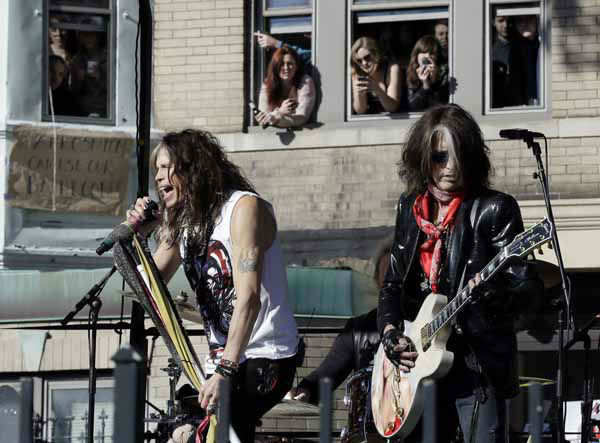 Aerosmith&#39;s Steven Tyler, left, and Joe Perry perform a free concert Monday, Nov. 5, 2012 in Boston&#39;s Allston neighborhood as fans watch from the apartment building which was their home in the early 1970&#39;s. &#40;AP Photo&#47;Elise Amendola&#41; <span class=meta>(AP Photo&#47; Elise Amendola)</span>