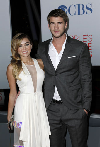 Miley Cyrus, left, and Liam Hemsworth arrive at the People&#39;s Choice Awards on Wednesday, Jan. 11, 2012 in Los Angeles.  <span class=meta>(AP Photo&#47;Matt Sayles)</span>