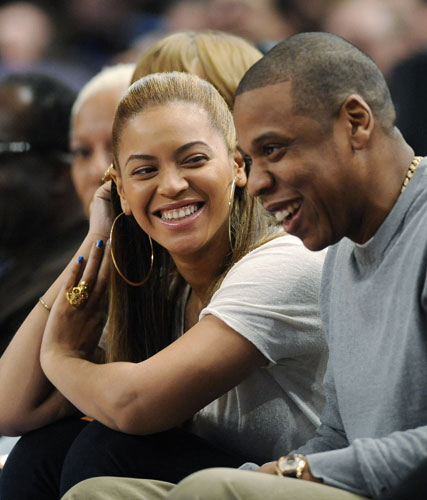 Entertainer Jay-Z reacts with his wife, Beyonce, left, during the third quarter of an NBA basketball game between the New York Knicks and New Jersey Nets, Monday, Feb. 20, 2012, at Madison Square Garden in New York.  <span class=meta>(AP Photo&#47;Bill Kostroun)</span>