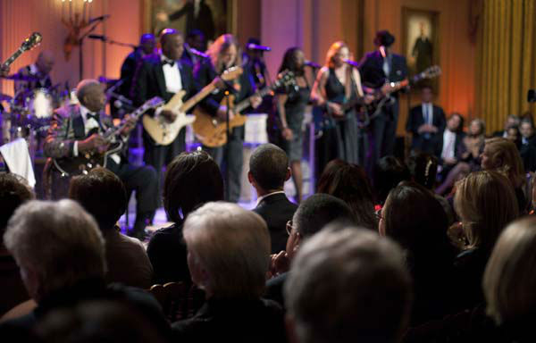 President Barack Obama and first lady Michelle Obama listen to performance during the White House Music Series saluting Blues Music in recognition of Black History Month, Tuesday, Feb., 21, 2012, in the East Room of the White House in Washington. On stage from left to right are B.B. King, Buddy Guy, Warren Haynes, Shemekia Copeland, Susan Tedeschi and Keb Mo. &#40;AP Photo&#47;Pablo Martinez Monsivais&#41; <span class=meta>(AP Photo&#47; Pablo Martinez Monsivais)</span>