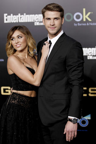 Liam Hemsworth, right, and Miley Cyrus arrive at the world premiere of &#34;The Hunger Games&#34; on Monday March 12, 2012 in Los Angeles.  <span class=meta>(AP Photo&#47;Matt Sayles)</span>