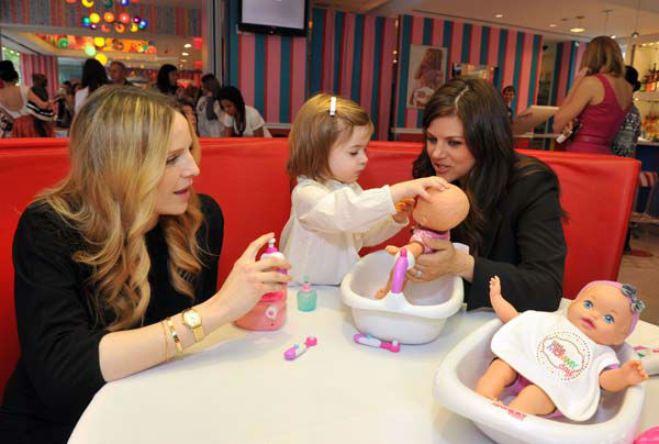 COMMERCIAL IMAGE - In this photograph taken by AP Images for Mattel, parenting expert Rosie Pope, left, star of Bravo&#39;s reality series, &#34;Pregnant in Heels,&#34; and Tiffani Thiessen with her daughter Harper, play with Little Mommy baby dolls at Mattel&#39;s Little Mommy Day event at Dylan&#39;s Candy Bar in New York, Thursday, April 26, 2012.  &#40;Diane Bondareff&#47;AP Images for Mattel&#41; <span class=meta>(Photo&#47;Diane Bondareff)</span>