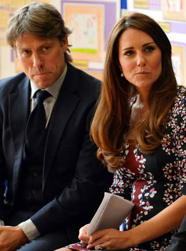 The Duchess of Cambridge sits with British comedian John Bishop and listens to speeches at The Willows Primary School, Wythenshawe, Manchester, England, where she launched a new school counselling programme, Tuesday April 23, 2013. &#40;AP Photo&#47;Paul Ellis, Pool&#41; <span class=meta>(AP Photo&#47; Paul Ellis)</span>