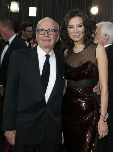 "<div class=""meta image-caption""><div class=""origin-logo origin-image ""><span></span></div><span class=""caption-text"">Rupert Murdoch, left, and Wendi Deng Murdoch arrive at the Oscars at the Dolby Theatre on Sunday Feb. 24, 2013, in Los Angeles. (Photo by Todd Williamson/Invision/AP) (Photo/Todd Williamson)</span></div>"