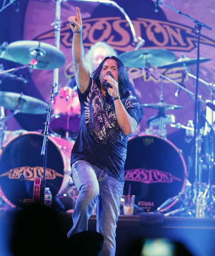 Tommy DeCarlo, lead singer of the group Boston, performs at the Boston Strong Concert: An Evening of Support and Celebration at the TD Garden on Thursday, May 30, 2013 in Boston. &#40;Photo by Bizuayehu Tesfaye&#47;Invision&#47;AP&#41; <span class=meta>(AP Photo&#47; Bizuayehu Tesfaye)</span>