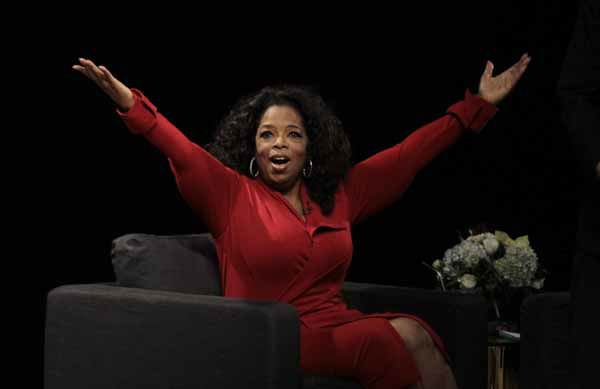 Oprah Winfrey acknowledges the audience after she came to the stage for an interview with Ball  State University alumnus David Letterman, host of CBS&#39;s &#34;Late Show,&#34; at Ball State University in Muncie, Ind., Monday, Nov. 26, 2012. The conversation is part of the David Letterman Distinguished Professional Lecture and Workshop Series. &#40;AP Photo&#47;Michael Conroy&#41; <span class=meta>(AP Photo&#47; Michael Conroy)</span>