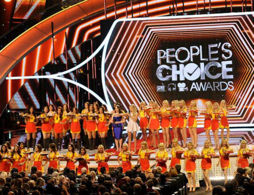 Hosts Kat Dennings and Beth Behrs, center, speak onstage at the 40th annual People&#39;s Choice Awards at Nokia Theatre L.A. Live on Wednesday, Jan. 8, 2014, in Los Angeles. &#40;Photo by Frank Micelotta&#47;Invision&#47;AP&#41; <span class=meta>(Photo&#47;Frank Micelotta)</span>