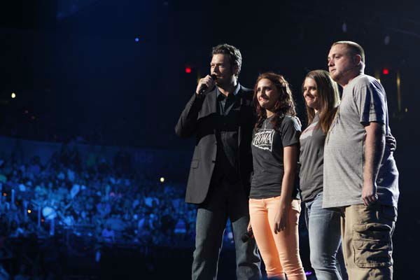 This image released by NBC Universal shows country singer Blake Shelton, left is shown on stage with Alyson Costilla, second left, 18, and her family during the Healing in the Heartland: Relief Benefit Concert at the Chesapeake Energy Arena in Oklahoma City, Okla., Wednesday, May 29,2013. Funds raised by the benefit will go to the United Way of Central Oklahoma, for recovery efforts for those affected by the May 20 tornado. Costilla lost her mother Terri Long in the storm. &#40;AP Photo&#47;NBC, Trae Patton&#41; <span class=meta>(AP Photo&#47; Trae Patton)</span>