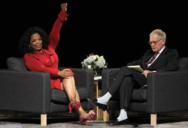 Oprah Winfrey reacts to a question from Ball State University alumnus David Letterman, right, host of CBS&#39;s &#34;Late Show,&#34; during an interview at Ball State University in Muncie, Ind., Monday, Nov. 26, 2012. The conversation is part of the David Letterman Distinguished Professional Lecture and Workshop Series. &#40;AP Photo&#47;Michael Conroy&#41; <span class=meta>(AP Photo&#47; Michael Conroy)</span>