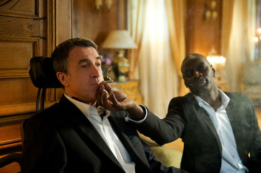 In this film image released by The Weinstein Company, Francois Cluzet, left, and Omar Sy are shown in a scene from &#34;The Intouchables.&#34;  The film was nominated for a Golden Globe for best foreign film on Thursday, Dec. 13, 2012. The 70th annual Golden Globe Awards will be held on Jan. 13. &#40;AP Photo&#47;The Weinstein Company, Thierry Valletoux&#41; <span class=meta>(AP Photo&#47; Thierry Valletoux)</span>