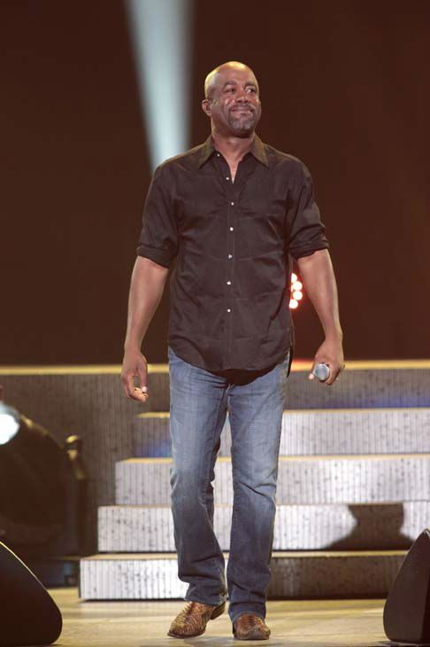 This image released by NBC Universal shows country singer Darius Rucker during the Healing in the Heartland: Relief Benefit Concert at the Chesapeake Energy Arena in Oklahoma City, Okla., Wednesday, May 29,2013. Funds raised by the benefit will go to the United Way of Central Oklahoma, for recovery efforts for those affected by the May 20 tornado. &#40;AP Photo&#47;NBC, Brett Deering&#41; <span class=meta>(AP Photo&#47; Brett Deering)</span>