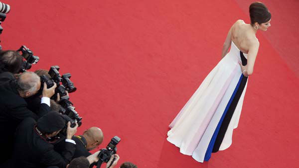 FILE - This May 20, 2013 file photo shows actress Marion Cotillard wearing a multi-colored bustier Dior dress with asymmetric hemline the screening of Blood Ties at the 66th international film festival, in Cannes, southern France. &#40;AP Photo&#47;Virginia Mayo, Pool&#41; <span class=meta>(AP Photo&#47; Virginia Mayo)</span>