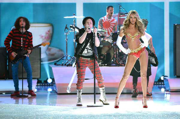 Fall Out Boy perform while model Candice Swanepoel walks the runway wearing the &#36;10 million Royal Fantasy Bra during the 2013 Victoria&#39;s Secret Fashion Show at the 69th Regiment Armory on Wednesday, Nov. 13, 2013 in New York. &#40;Photo by Evan Agostini&#47;Invision&#47;AP&#41; <span class=meta>(Photo&#47;Evan Agostini)</span>