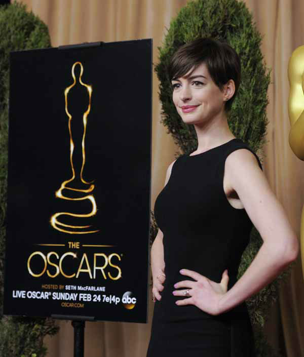 "<div class=""meta ""><span class=""caption-text "">Anne Hathaway, nominated for best actress in a supporting role for ""Les Miserables,"" arrives at the 85th Academy Awards Nominees Luncheon at the Beverly Hilton Hotel on Monday, Feb. 4, 2013, in Beverly Hills, Calif. (Photo by Chris Pizzello/Invision/AP) (Photo/Chris Pizzello)</span></div>"