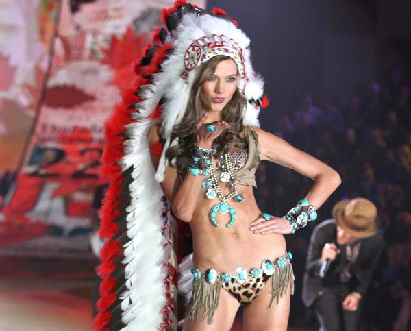 This Nov. 7, 2012 photo released by Starpix shows model Karlie Kloss wearing an Indian headdress during the taping of The 2012 Victoria&#39;s Secret Fashion Show in New York. Victoria Secret has apologized for putting a replica of a Native American headdress on a model for its annual fashion show. The company responded to criticism over the weekend by saying it was sorry to have upset anyone and would not include the outfit in the show?s television broadcast next month. &#40;AP Photo&#47;Starpix, Amanda Schwab&#41; <span class=meta>(AP Photo&#47; Amanda Schwab)</span>