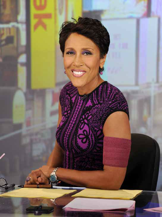 FILE - This June 26, 2012 file image originally released by ABC shows co-host Robin Roberts wearing an armband that covers her pic line chemotherapy treatment, on &#34;Good Morning America,&#34; in New York. Roberts is taking a little time off, saying she&#39;s feeling the effects of her blood and bone marrow disease. Roberts said Tuesday that she&#39;s ?not feeling too well? and would take some time off ?just to get some vacay.? ABC said Roberts would be taking a few weeks of previously scheduled time off, but it came earlier than her planned medical leave for a bone marrow transplant. Roberts announced last month that she has MDS, a blood and bone marrow disease once known as preleukemia.   &#40;AP Photo&#47;ABC, Ida Mae Astute&#41; <span class=meta>(AP Photo&#47; Ida Mae Astute)</span>
